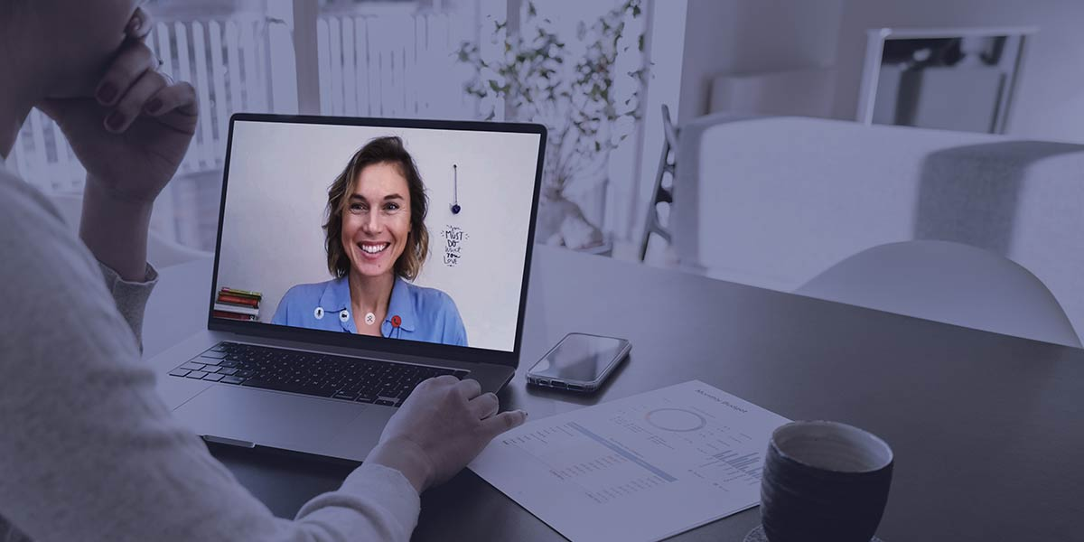 manager and employee meeting via video chat