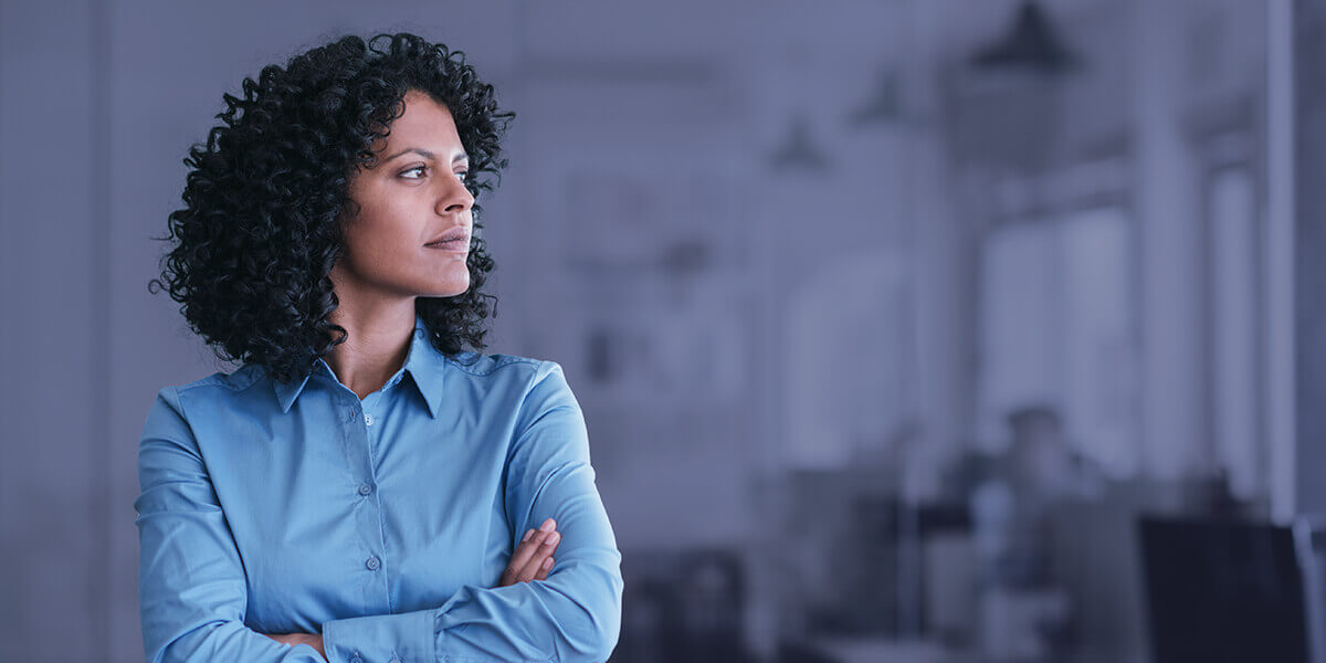 woman looking thoughtful in an office